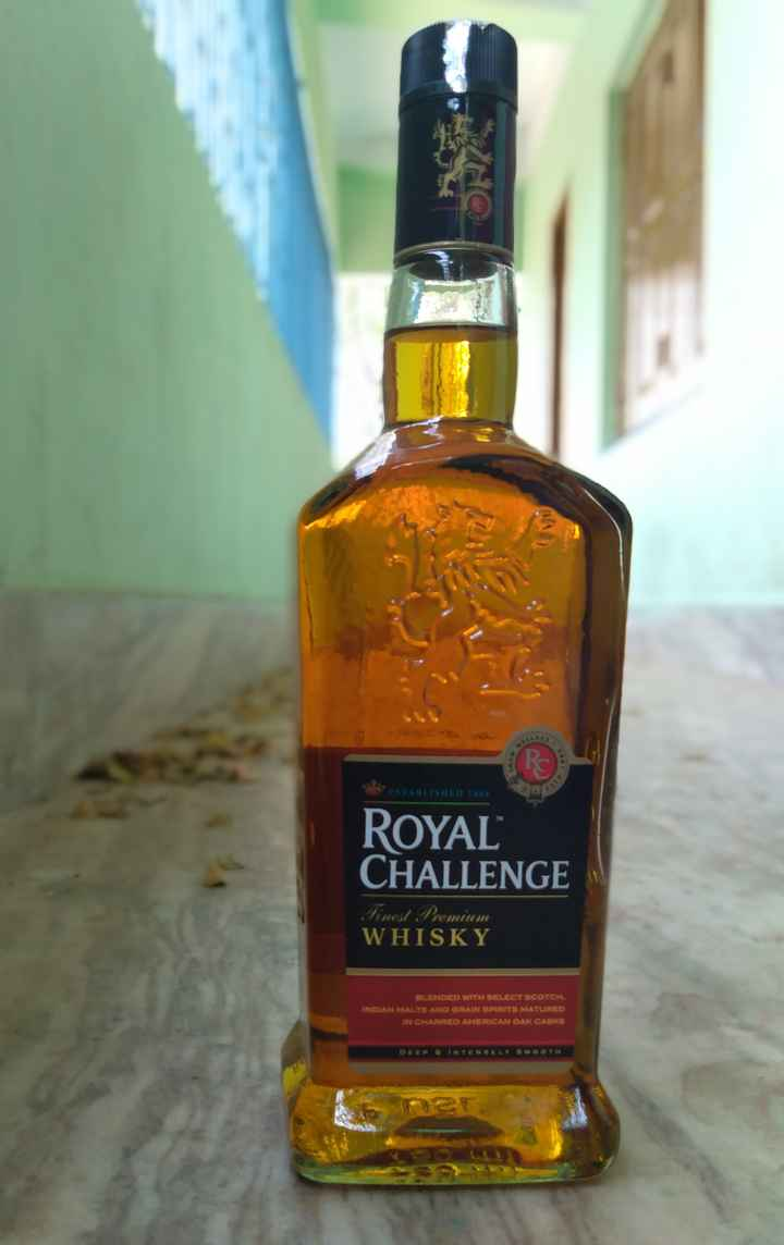 হ্যাপি হোলি - ESTABLISHED 1880 ROYAL CHALLENGE Finol Premium WHISKY OLENDED WITN SELECT SCOTCH . INDIAN MALTS AND GRAIN SPUITS MATURED IN CHARED AMERICAN GAK GASICS - ShareChat