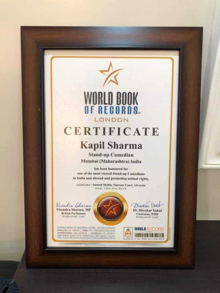 kapil sharma comedy - WORLD BOOK OF RECORDS LONDON CERTIFICATE Kapil Sharma Stand - up Comedian Mumbai ( Maharashtra ) India has been honoured for one of the most viewed Stand - up Comedians in India and abroad and promoting animal rights . Adjudicatur - Santosh Shukta Supreme Court , Aducate DATE 19TH MAV 19 Vendia Shaina Virendra Sharma , MP British Parliament ENGLAND TUR Dinner and Dr . Diwakar Sukul Chairman , WUR ENGLAND TUR HOE OF BEDROOM SELAIN RELIG WORLD RECORD - ShareChat